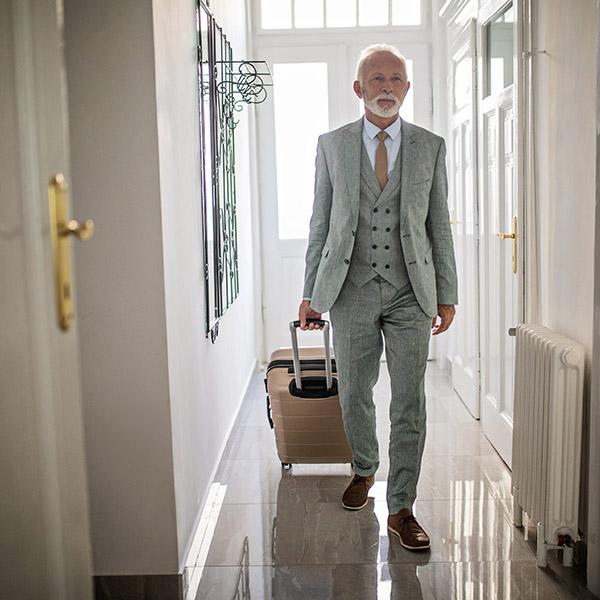 man in hotel corridor