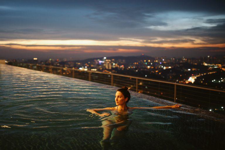 woman in rooftop pool